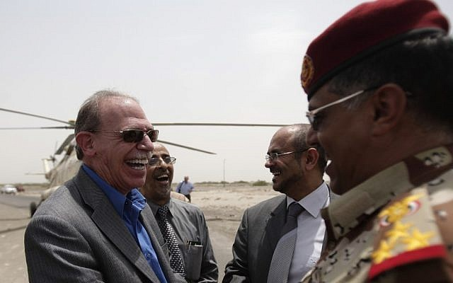 US Ambassador to Yemen Gerald M. Feierstein, left, shakes hands with a Yemeni army officer during a visit to Abyan, Yemen. Al-Qaida's branch in Yemen has offered to pay tens of thousands of dollars to anyone who kills Feierstein or an American soldier in the country, according to an audio produced by the group's media arm, the al-Malahem Foundation, and posted on militant websites Saturday, December 29, 2012. (photo credit: AP/Hani Mohammed, File)