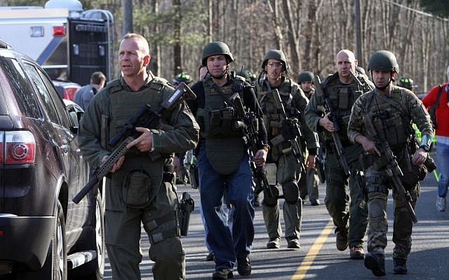 Heavily armed Connecticut State troopers on the scene at Sandy Hook Elementary School in Newtown, Connecticut, December 2012 (photo credit: AP/The Journal News, Frank Becerra Jr.)