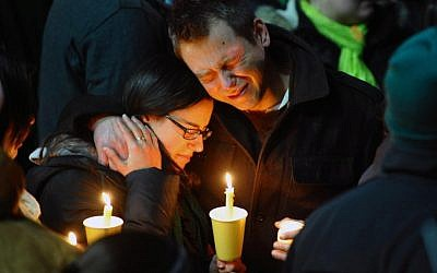 Ted Kowalczuk, of Milford, Conn., and his friend Rachel Schiavone, of Norwalk, Conn., attend a candlelight vigil held behind Stratford High School on the Town Hall Green in Stratford, Conn. on Saturday. Kowalczuk and Schiavone were close friends of Stratford High graduate Vicki Soto, who was killed in Friday's mass shooting at Sandy Hook Elementary School in Newtown. Soto was a teacher at the school. (AP Photo/The Connecticut Post, Christian Abraham)
