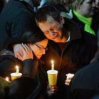 Mourners attend a candlelight vigil held behind Stratford High School on the Town Hall Green in Stratford, Connecticut on Saturday December 15, 2012, remembering victims of the mass shooting at Sandy Hook Elementary School in nearby Newtown. (The Connecticut Post, Christian Abraham/AP)
