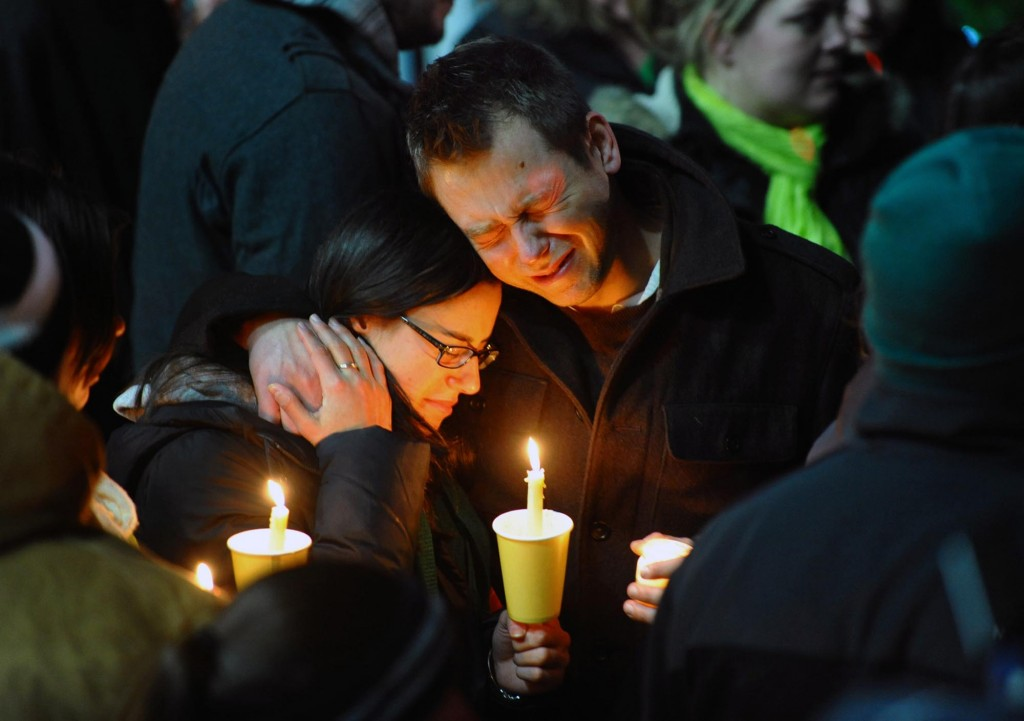 Mourners attend a candlelight vigil held behind Stratford High School on the Town Hall Green in Stratford, Connecticut on Saturday December 15, 2012, remembering victims of the mass shooting at Sandy Hook Elementary School in nearby Newtown. (photo credit: The Connecticut Post, Christian Abraham/AP)