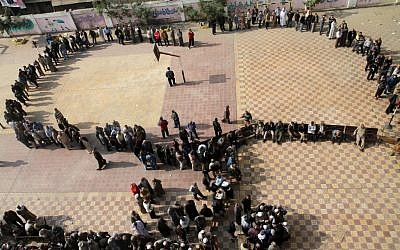 Egyptians wait in line to cast their votes during a referendum on a disputed constitution drafted by Islamist supporters of President Morsi in Cairo, Egypt, Saturday, Dec. 15, 2012. (Photo credit: AP/Ahmed Gomaa)