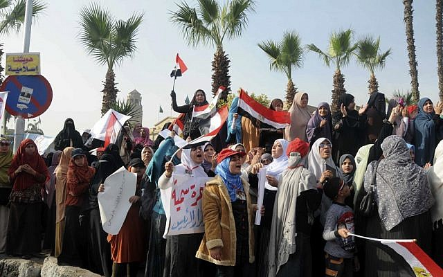 Supporters of Egyptian President Mohammed Morsi rally in front of Cairo University, Cairo, Egypt, Saturday, Dec. 1, 2012 (photo credit: AP/Mohammed Assad)