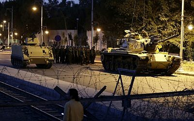 An Egyptian Army tank deploys outside the presidential palace in Cairo on Thursday, December 6, 2012, to control crowds of anti-government protesters (photo credit: AP/Hassan Ammar)
