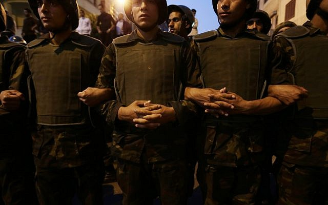 Egyptian soldiers stand guard near the presidential palace in Cairo, Egypt, Sunday, December 9, 2012. (photo credit: AP/Hassan Ammar)