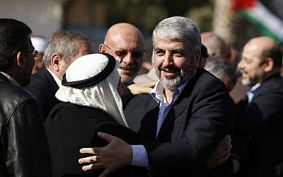 Exiled Hamas chief Khaled Mashaal upon his arrival at Rafah crossing in the southern Gaza Strip, Friday, Dec. 7, 2012 (photo credit: AP/Sohaib Salem)