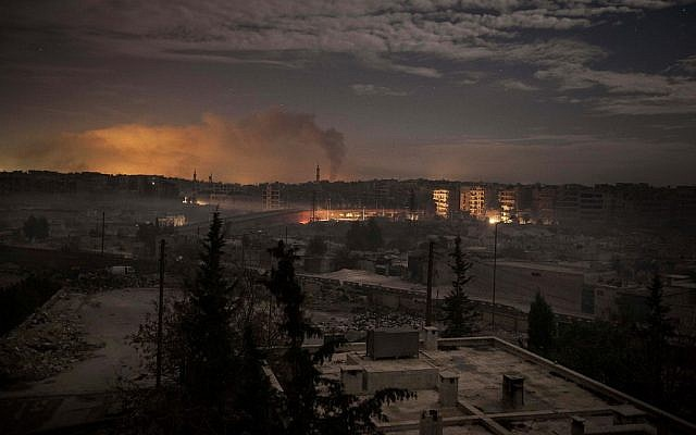 Smoke rises from buildings in Aleppo on Saturday due to heavy fighting between Free Syrian Army fighters and government forces. (photo credit: AP/Narciso Contreras)