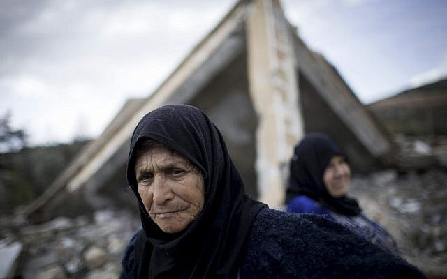 Syrian women amid the ruins of their farm, destroyed by Syrian Army jets (photo credit :Manu Brabo/AP)