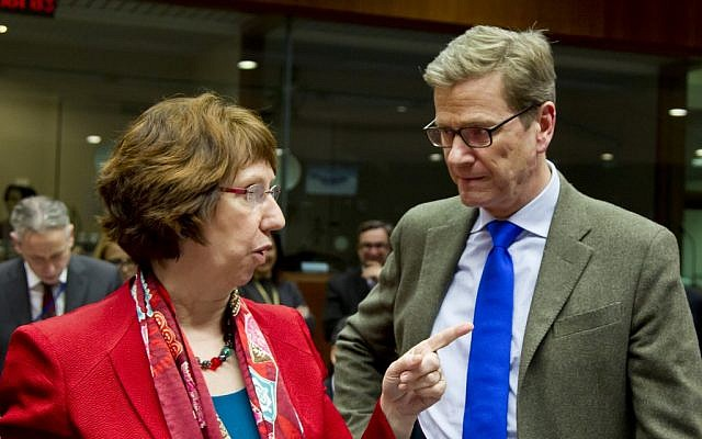 EU High Representative Catherine Ashton, left, speaks with German Foreign Minister Guido Westerwelle during a meeting of EU foreign ministers at the EU Council building in Brussels on Monday, Dec. 10 (photocredit: AP/Virginia Mayo)