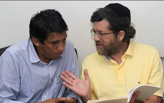 New York businessman Jacob Ostreicher, right, consults with attorney Abel Montano at a courthouse in Bolivia, where he was being held without charges (photo credit: AP/File)
