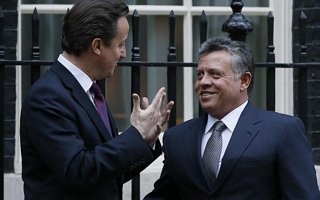Britain's Prime Minister David Cameron, left, greets King Abdullah II of Jordan at Downing Street in London, Tuesday, Dec. 11, 2012. (photo credit: AP/Kirsty Wigglesworth)