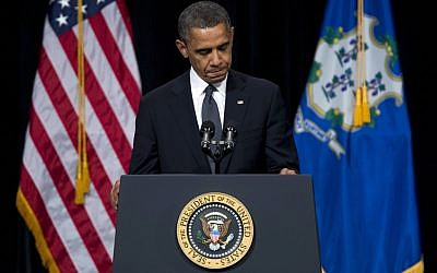 US Pesident Barack Obama pauses during a speech on Dec. 16, 2012. (photo credit: Evan Vucci/AP)