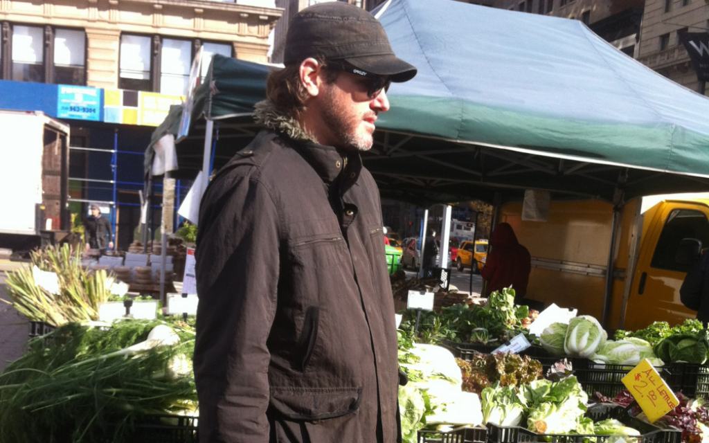 Chris Mitchell, chef at the kosher Manhattan restaurant Jezebel, buys ingredients at a local farmers market, where the produce comes from nearby farms. (Chavie Lieber/JTA)