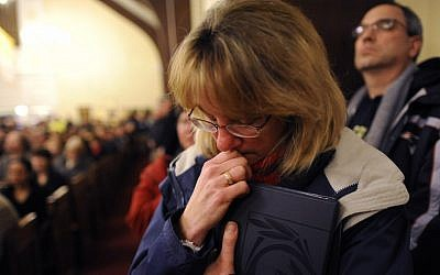 Mourners gather at a vigil service for victims of the Sandy Hook Elementary School shooting in Newtown, Connecticut, on Friday (photo credit: AP/Andrew Gombert)