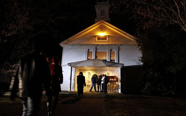 People arrive for a prayer service at Newtown United Methodist Church in the aftermath of a mass shooting at nearby Sandy Hook Elementary School. (photo credit: AP/Jason DeCrow)