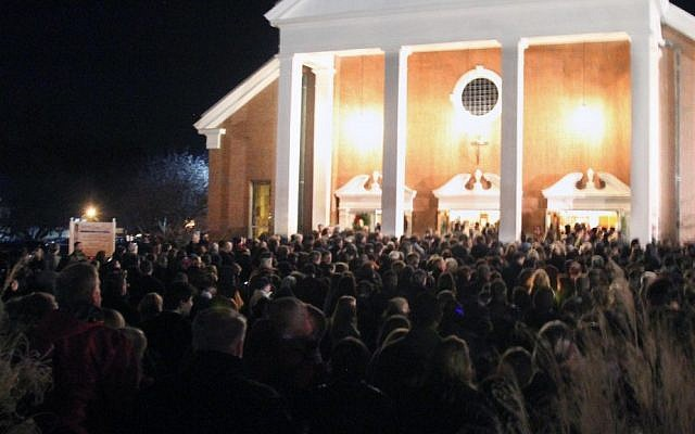 Thousands attend a vigil for the victims of the school shooting at Saint Rose of Lima church, Friday, Dec. 14, 2012 in Newtown, Conn. (photo credit: AP)