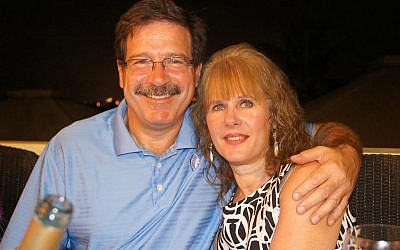 Mark Sherlach and his wife, school psychologist Mary Sherlach, pose for a photo. Mary Sherlach was killed Friday, December 14, when a gunman opened fire at Sandy Hook Elementary School, in Newtown, Connecticut, killing 26 children and adults at the school (photo credit: AP/Courtesy of Mark Sherlach)