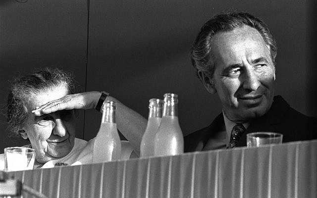 Shimon Peres, right, with Golda Meir (photo credit: GPO)
