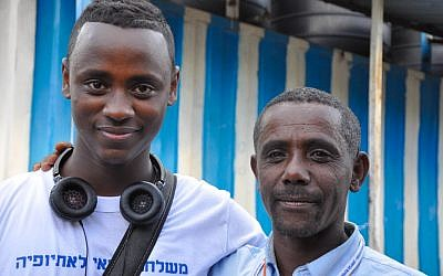 Daniel Toajo Bekele with his uncle, Almo Wobie, who works as a security guard at the synagogue in Gondar, Ethiopia. Their encounter was the first time Danny met his father's brother, who does not have permission to come to Israel. (photo credit: Michal Shmulovich/ToI)