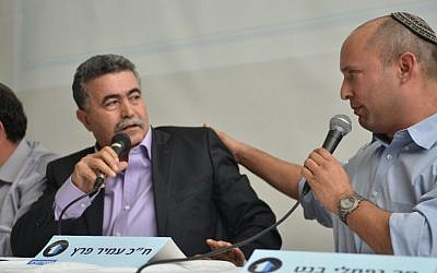 Jewish Home leader Naftali Bennett (right) and Hatnua no. 2 Amir Peretz take part in a panel debate on the Israel-Palestinian conflict, on Sunday, Dec. 23 (photo credit: Dotan Gur/courtesy)