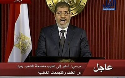 Egyptian President Mohammed Morsi delivers a televised statement in Cairo, Egypt, Thursday, December 6, 2012. (photo credit: AP/Nile TV)
