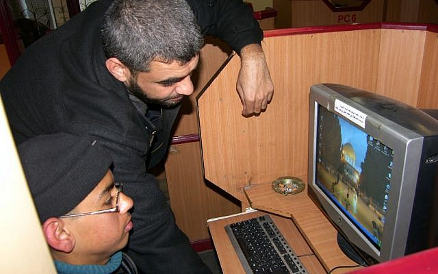 Palestinian youth in an Internet cafe in Gaza, March 2007 (photo credit: Ahmad Khatib/Flash90)