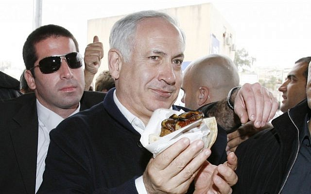 Prime Minister Benjamin Netanyahu enjoying falafel in Acre, December 2012. (photo credit: Michal Fattal/Flash90)
