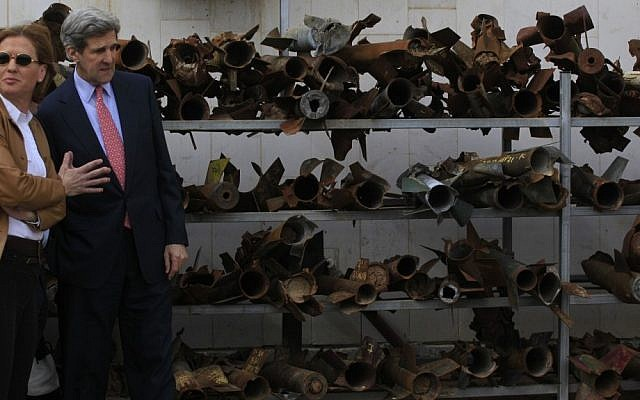 US Senate Foreign Relations Committee Chairman John Kerry, with then foreign minister and Kadima party leader Tzipi Livni, stand next to the remains of rockets fired from Gaza, at a police station in Sderot, in Feb. 2009. (photo credit: Tsafrir Abayov/Flash90)