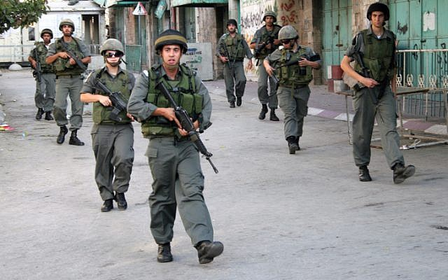 Israel Border Police on patrol in Hebron. (Najeh Hashlamoun/Flash90)