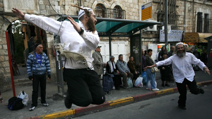 Ultra Orthodox Jewish followers of the Hassidic Breslov sect dance in a Jerusalem street, November 2009 (photo credit: Miriam Alster/Flash90)