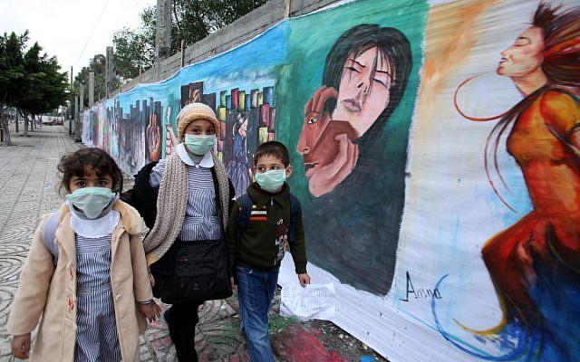 Illustrative. Palestinian schoolchildren wearing protective masks during an outbreak of a virus in 2009 (photo credit: Wissam Nassar/Flash 90)