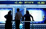 People watch a board showing stock fluctuations at the Tel Aviv stock exchange. (photo credit: Moshe Shai/FLASH90)