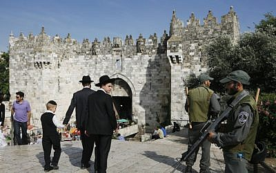 Ultra-Orthodox Jews walk toward Damascus Gate in Jerusalem's Old City, May 2010. (photo credit: Miriam Alster/Flash90)