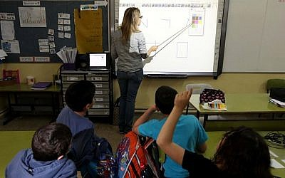 A teacher using a touchscreen 'smart board' in a Jerusalem classroom. (Kobi Gideon/Flash90)