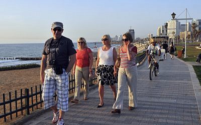 Tourists take a stroll on the Tel Aviv promenade (photo credit: Serge Attal/Flash90)