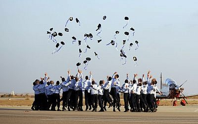 Israeli Air Force pilots throw their caps in the air during a graduation ceremony at the Hatzerim air force base, Thursday, June 30, 2011. (photo credit Michael Shvadron/IDF Spokesperson/Flash90)