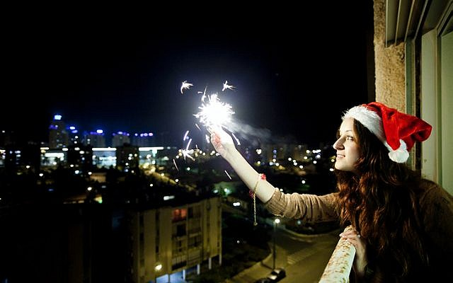 A woman celebrates the New Year in Israel, January 1, 2012. (photo credit: Dima Vazinovich/Flash90)