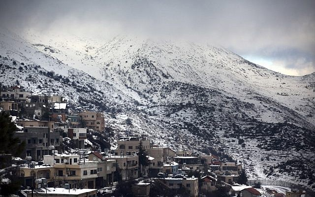 A view of a snow-clad Mount Hermon as seen from the village of Majdal Shams on January 12, 2012 (photo credit: Matanya Tausig/Flash90)