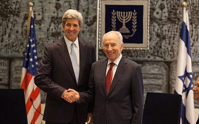 President Shimon Peres meets with US Senator John Kerry at the President's Residence in Jerusalem in May 2012 (photo credit: Uri Lenz/Flash90)