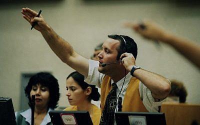 A broker at the Tel Aviv Stock Exchange (photo credit: Moshe Shai/Flash90)