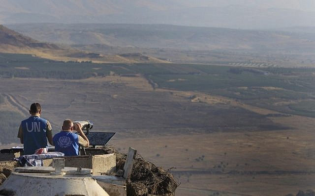 UN peacekeepers monitor the Syrian side of the Israeli-Syrian border from an army post at Mount Bental in the Golan Heights last July (photo credit: Tsafrir Abayov/Flash90)