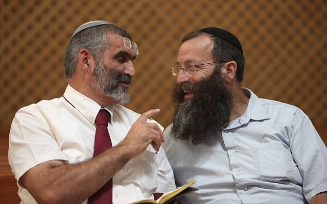 File: Baruch Marzel speaks with MK Michael Ben-Ari, Sep 6 2012. (Yoav Ari Dudkevitch/Flash90)