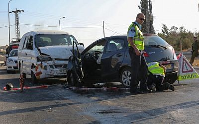 Policemen at the scene of a car accident, September 2012 (photo credit: Oren Nahshon/Flash90)