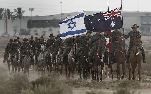 Australian men and women reenacting the last cavalry charge that took place in the Battle of Beersheba during World War I. (Tsafrir Abayov/Flash90)