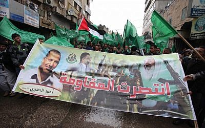 Hamas supporters celebrate in the West Bank city of Ramallah following operation Pillar of Defense, November 23, 2012 (photo credit: Issam Rimawi/Flash90)