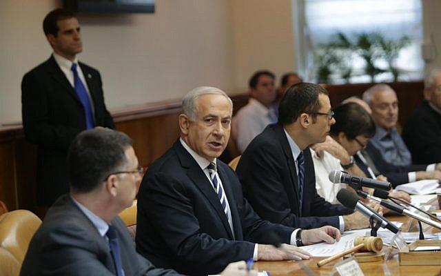 Benjamin Netanyahu leading the weekly cabinet meeting in Jerusalem on Sunday. (photo credit: Alex Kolomoisky/Pool/Flash90)