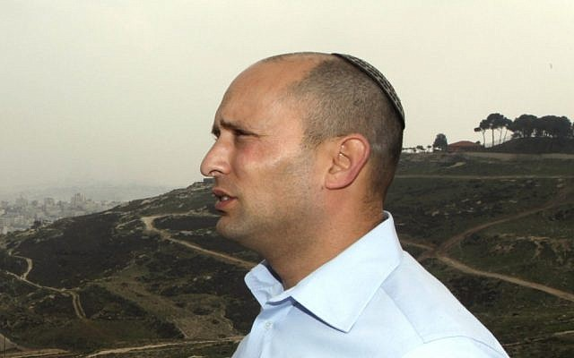 Jewish Home party leader Naftali Bennett. In the background is the controversial strip of land known as E1, between Jerusalem and the settlement of Ma'aleh Adumim. (photo credit: Flash90)