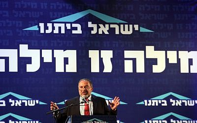 Foreign Minister Avigdor Liberman presents Israel Beytenu's party slate at a Jerusalem press conference on Tuesday, December 4. (photo credit: Yoav Ari Dudkevitch/Flash90)