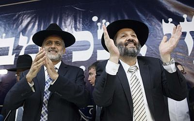 Ex-Shas member Eli Yishai (left) and Shas party chairman Aryeh Deri cheer during a party conference in Jerusalem, December 4, 2012. (photo credit: Yonatan Sindel/Flash90)