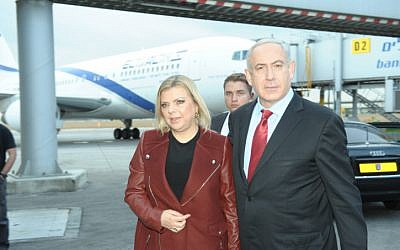 Prime Minister Benjamin Netanyahu and his wife Sara make their way to Prague on Wednesday, December 5. (photo credit: Amos Ben Gershom/GPO/Flash90)